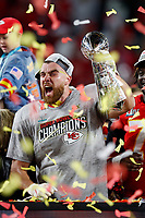 Kansas City Chiefs tight end Travis Kelce (87) holds up the Vince Lombardi Trophy after the NFL Super Bowl 54 football game between the San Francisco 49ers and Kansas City Chiefs Sunday, Feb. 2, 2020, in Miami Gardens, Fla<br /> <br /> ( Tom DiPace via AP)