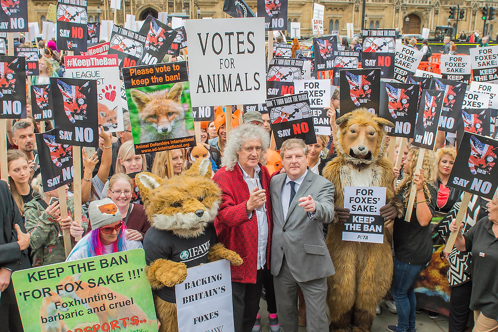 Brian May with Angus Robertson MP Ahead of Wednesday's free vote, Brian May (Queen guitarist and committed animal campaigner) and Angus Robertson MP, Leader of the SNP in Westminster – along with May's Save Me Trust, PETA, the RSPCA, the League Against Cruel Sports, Born Free, Lush and Humane Society International – protest in Westminster, urging policymakers to 'keep Britain humane by keeping the Hunting Act intact'. While there they hear that the vote has been postponed.