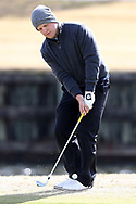 WILMINGTON, NC - MARCH 19: Kent State's Bjarki Petursson (ISL) putts on the Ocean Course seventh hole. The first round of the 2017 Seahawk Intercollegiate Men's Golf Tournament was held on March 19, 2017, at the Country Club of Landover Nicklaus Course in Wilmington, NC.