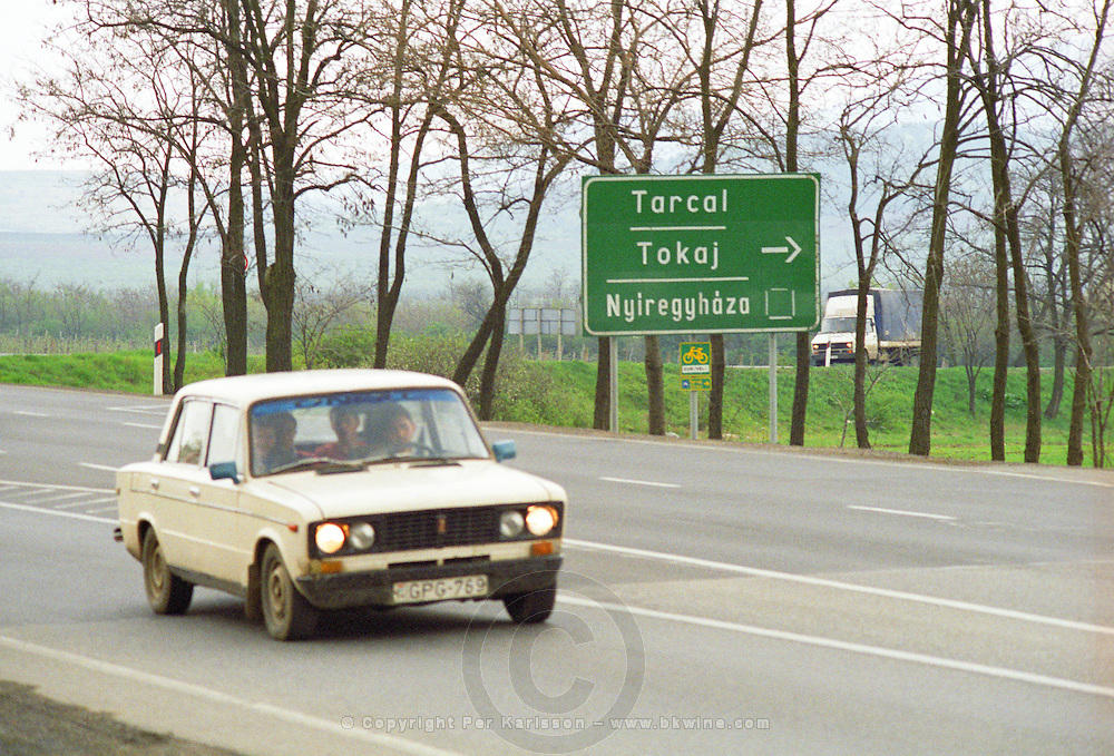 Tokaj: A road sign showing the way to the Tokaj and Tarcal villages. A rusty vintage Trabant car with four people Credit Per Karlsson BKWine.com