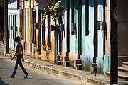 A woman walks across the street in Baracoa, Cuba on Monday July 14, 2008.
