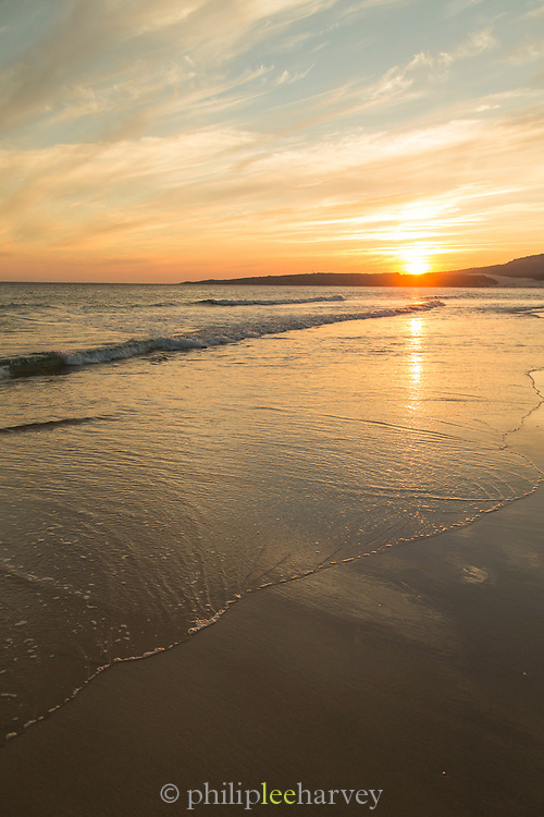 View of beach and sea at sunrise, Bolonia, Andalusia, Spain