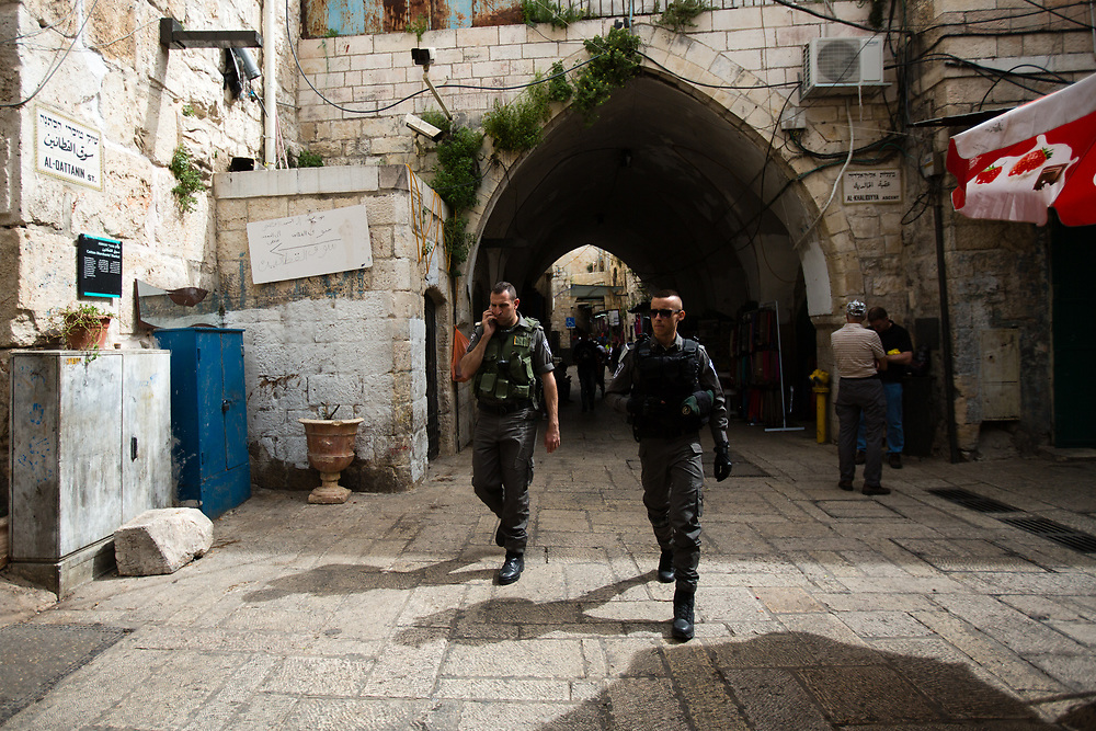 Israeli Border Police Men are seen as they walk through HaGai Street or al Wad Street in the Muslim quarter of the Old City of Jerusalem, Israel, on April 10, 2016.