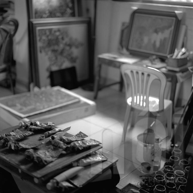 Black&white film photograph of painter Pham Viet Hong Lam's studio of in Hanoi, Vietnam, Southeast Asia