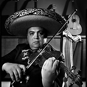Alex Treviño plays the violin in the Grammy nominated group Mariachi Los Arrieros del Valle, he also is the director of McAllen High School's Mariachi Oro. (4X5 Ilford HP5) photo by Nathan Lambrecht