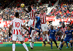 Stoke City's Glen Johnson (top left) jumps highest to win the ball during the Premier League match at the bet365 Stadium, Stoke-on-Trent.