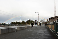 Melbournians enjoy their one hour of outside time as a rainbow forms behind them during COVID-19 in Melbourne, Australia. Hotel quarantine linked to 99% of Victoria's COVID-19 cases, inquiry told. This comes amid a further 222 new cases being discovered along with 17 deaths. Melbourne continues to reel under Stage 4 restrictions with speculation that it will be extended. (Photo by Dave Hewison/Speed Media)