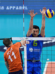 Dick Kooy #11, Mitja Gasparini during volleyball match between National teams of Netherlands and Slovenia in Playoff of 2015 CEV Volleyball European Championship - Men, on October 13, 2015 in Arena Armeec, Sofia, Bulgaria. Photo by Ronald Hoogendoorn / Sportida