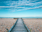 Dungeness beach with wooden footpath, Kent, UK