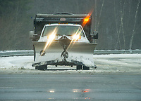Spring will have to wait as the Lakes Region gets through another snowstorm to begin the week.  A Belknap Landscape plow truck comes out of Hounsell Ave. on Monday morning.  (Karen Bobotas/for the Laconia Daily Sun)