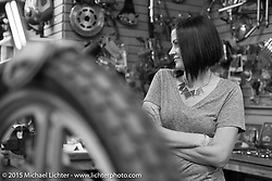 Mrs Noise (Summer Jones) in the shop for final prep of builder invite bikes at Noise Cycles the night before Born Free 6. Santa Ana, CA. USA. June 26, 2014.  Photography ©2014 Michael Lichter.