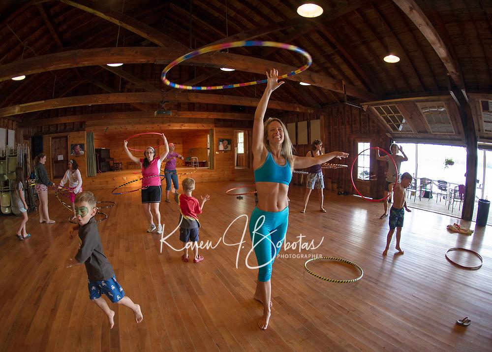 Erin Lovett Sherman demonstrates a hoop class during her artist in residence with Sandy Island Family Camp on Lake Winnipesaukee Friday morning.  (Karen Bobotas/for the Laconia Daily Sun)