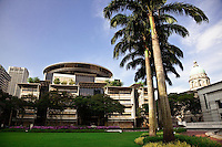 The new supreme court building in Singapore with the former colonial styled building in the background.