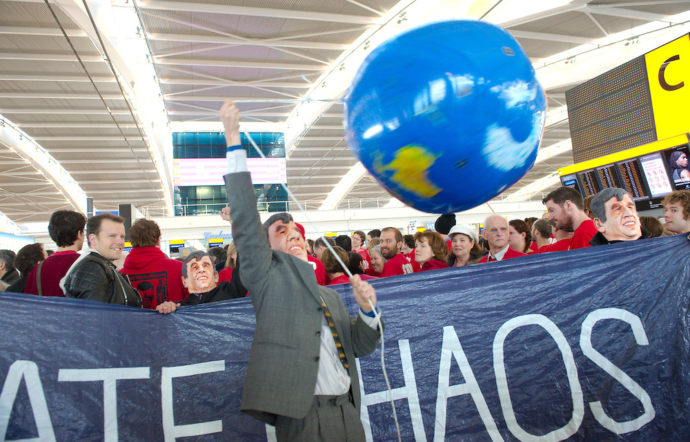 .Heathrow  Jan 17 Flashmob  at Heathrow Terminal 5  after the controversial government decision on Heatrow Expansion and the building od a third runway...Standard Rates Apply.XianPix Pictures  Agency  tel +44 (0) 845 050 6211 e-mail sales@xianpix.com www.xianpix.com