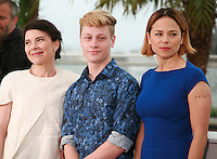 Anne Dorval, Antoine-Olivier Pilon and Suzanne Clément at the photo call for the film Mommy at the 67th Cannes Film Festival, Thursday 22nd May 2014, Cannes, France.