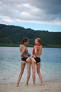 Port Barton, Palawan, Philippines - July 7, 2019:  Hortense from France and Ana from Spain stand on Capsalay Island near Port Barton with fresh sunburns.