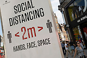 Social distancing signs are still in place outside Oxford Circus station on Oxford Street as the national coronavirus lockdown three eases towards the planned Freedom Day on 22nd July 2021 in London, United Kingdom. Now that the roadmap for coming out of the national lockdown and easing of restrictions is set, dome medical professionals are suggesting thatsome safety measures are kept in place because of the increase in the Delta variant.
