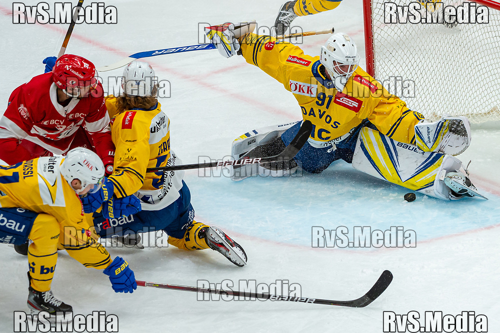 LAUSANNE, SWITZERLAND - SEPTEMBER 24: Goalie Gilles Senn #91 of HC Davos makes a save during the Swiss National League game between Lausanne HC and HC Davos at Vaudoise Arena on September 24, 2021 in Lausanne, Switzerland. (Photo by Robert Hradil/RvS.Media)