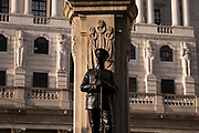 The figure of a fallen soldier of the First World War and an exterior of the Bank of England in the City of London, on 1st March 2021, in London, England.