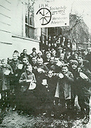German children receive soup at a communal kitchen during the poverty years of the depression in Weimar Germany c1923.