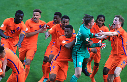 Netherlands U17's players celebrate winning the shoot out