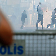 Clashes erupt between police and protesters during May Day celebrations in Istanbul, Turkey, Wednesday May 1, 2013. The government, citing security reasons, banned a rally on Istanbul's Taksim Square, which is undergoing major renovations. Police fired tear gas to disperse hundreds of demonstrators trying to break through barricades to access the square. May 1 demonstrations in Istanbul organized demonstrators clashed with police in protest against the government. Events, many demonstrators were injured, a large number of people affected by the tear gas used by police. Photo by AYKUT AKICI/TURKPIX