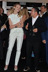 NASIB PIRIYEV and NATALIA VODIANOVA at the Chovgan Twilight Polo Gala in association with the PNN Group held at Ham Polo Club, Petersham Close, Richmond, Surrey on 10th September 2014.
