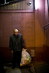 Hiroshi, 58, unemployed day laborer, collects cans for living in Kamagasaki, Japan.