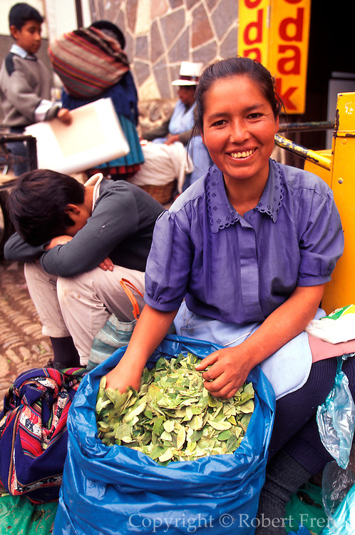 PERU, HIGHLANDS, MARKETS Pisac; vendor selling coca leaves
