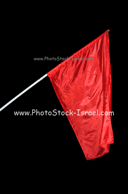 The red communist movement flag flying high during a protest on the changes in the 2007 budget in Israel