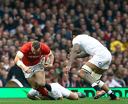 Hadleigh Parkes of Wales is tackled by Jamie George of England<br /> <br /> Photographer Simon King/Replay Images<br /> <br /> Six Nations Round 3 - Wales v England - Saturday 23rd February 2019 - Principality Stadium - Cardiff<br /> <br /> World Copyright © Replay Images . All rights reserved. info@replayimages.co.uk - http://replayimages.co.uk