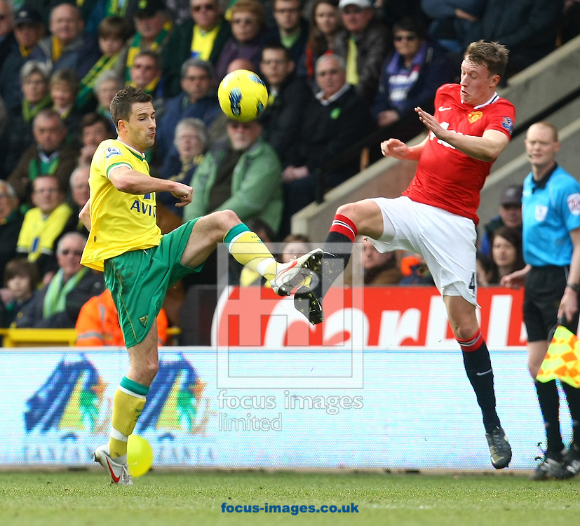 Picture by Paul Chesterton/Focus Images Ltd.  07904 640267.26/02/12.Phil Jones of Man Utd and Adam Drury of Norwich in action during the Barclays Premier League match at Carrow Road Stadium, Norwich.