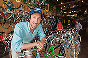Parkside Bikes owner Ben Botkins shows off an array of new bicycles, while Jef Meyers helps customer Susan Albright. - See more at: http://www.thehighlanderonline.com/print-articles/down-to-business/643-life-cycles#sthash.4xVhp5cB.dpuf<br /> <br /> Parkside Bikes, photographed Thursday, June 20, 2013 in Louisville, Ky. (Photo by Brian Bohannon)