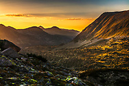 Splendid mountain valley lighted in golden light at the and of the long summer day