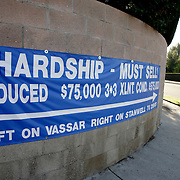"""LOS ANGELES, CA, September 26, 2007: The housing market across the nation shows continued signs of weakness as more homes, including foreclosures, are for sale in Los Angeles on September 26, 2007. A banner advertises a """"hardship"""" sale. (Photo by Todd Bigelow/Aurora)"""