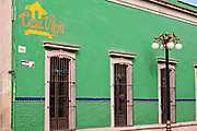 Bright green walls of the Casa Vieja restaurant and bar in the state capital of San Luis Potosi, Mexico.