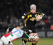 Wycombe, GREAT BRITAIN,   Wasps' James HASKELL. hands of Danny CARE during the London Wasps vs Harlequins at Adam's Park Stadium, Bucks on Sun 04.01.2009. [Photo, Peter Spurrier/Intersport-images]