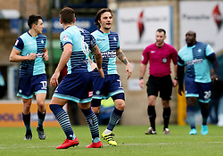 Wycombe Wanderers' Sam Saunders (right) is congratulated by team mate Adam El-Abd (left) after scoring his side's first goal during the Emirates FA Cup, second round match at Adams Park, Wycombe.