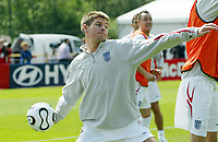 Photo: Chris Ratcliffe.<br />England training session. 06/06/2006.<br />Steven Gerrard during training before sitting it out at the end with a stiff back.