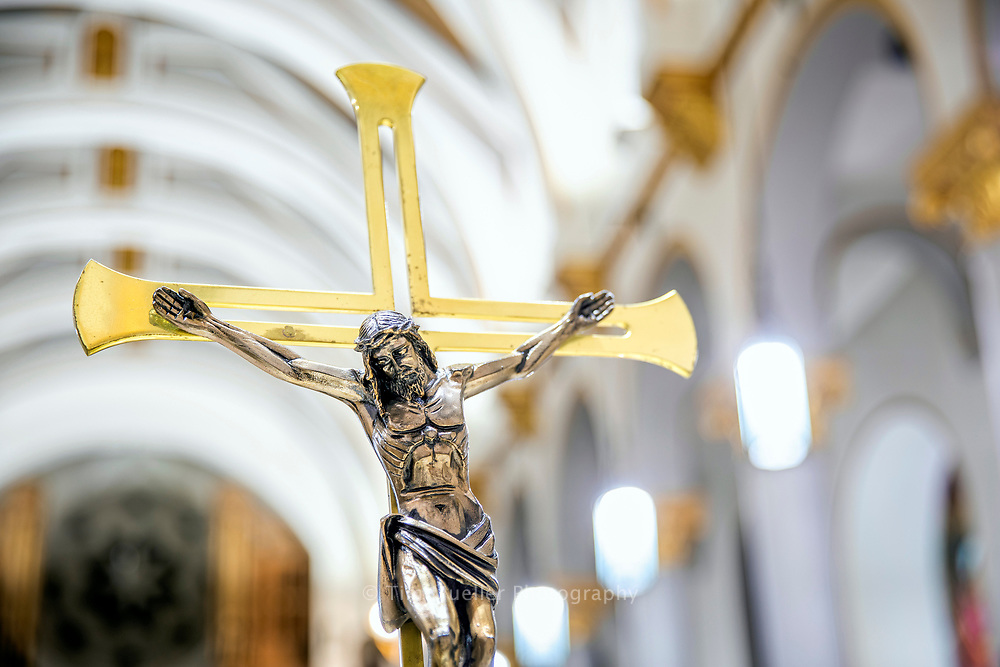 Gold and silver Crucifix in the nave of Sacred Heart of Jesus Catholic Church in Baton Rouge, La.