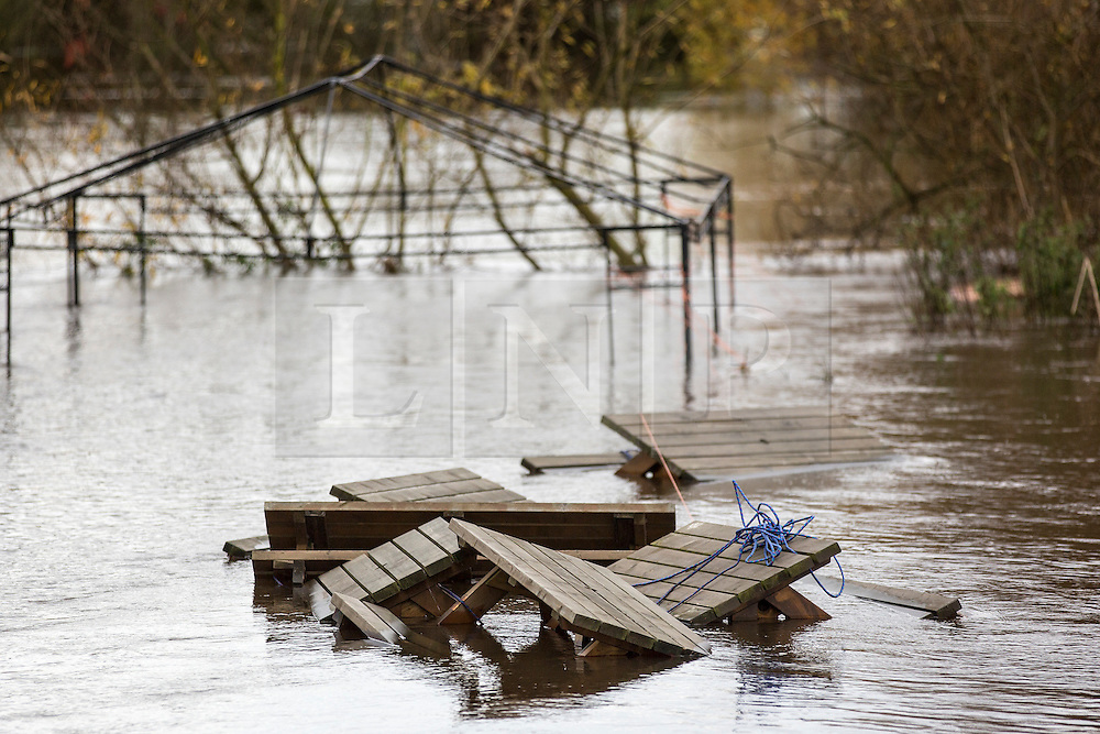 © Licensed to London News Pictures. 19/11/2015. Cawood UK. Picture shows the flooded beer garden of the Ferry Inn at Cawood after the River Ouse  water level reached 6.61 metres this morning. The Environment Agency has issued 12 flood alerts for Yorkshire with more flooding expected. Photo credit: Andrew McCaren/LNP