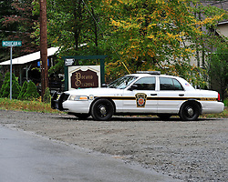 A State Police car monitors traffic into the development where the Frein family lives. Police converge on Barrett Township in the Pocono Mountains in search of ambush suspect Eric Matthew Frein who is accused of shooting two Pennsylvania State Troopers Sept. 25th, 2014 in Canadensis, Pennsylvania (Chris Post | lehighvalleylive.com)