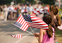 Children watching the Memorial Day Parade in Gilford, NH.   (Karen Bobotas for the Laconia Daily Sun