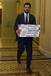 July 27, 2017 - Washington, District Of Columbia, USA - A senate staffer carries pizza outside the senate chamber prior to a health care vote. (Credit Image: © Alex Edelman via ZUMA Wire)