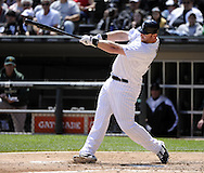 CHICAGO - JUNE 12:  Adam Dunn #32 of the Chicago White Sox hits a three-run home run in the fourth inning against the Oakland Athletics on June 12, 2011 at U.S. Cellular Field in Chicago, Illinois.  The White Sox defeated the Athletics 5-4.  (Photo by Ron Vesely)   Subject:  Adam Dunn