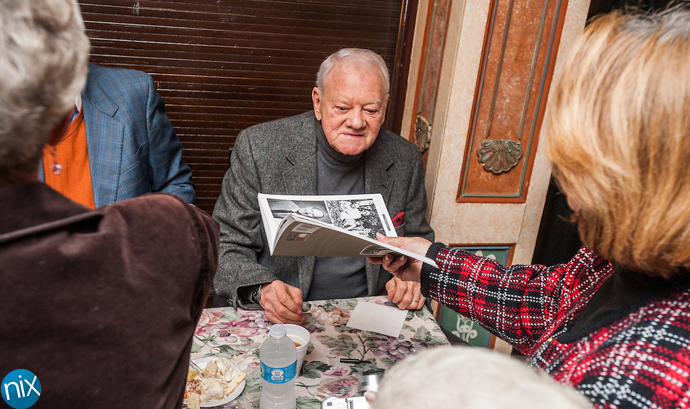 """Radio Personality Bob Raiford signs books during Legendary Locals Day at the Old Courthouse Theatre in Concord Sunday afternoon. The various """"legendary celebrities"""" are from historian Michael Eury's new book """"Legendary Locals of Concord."""""""