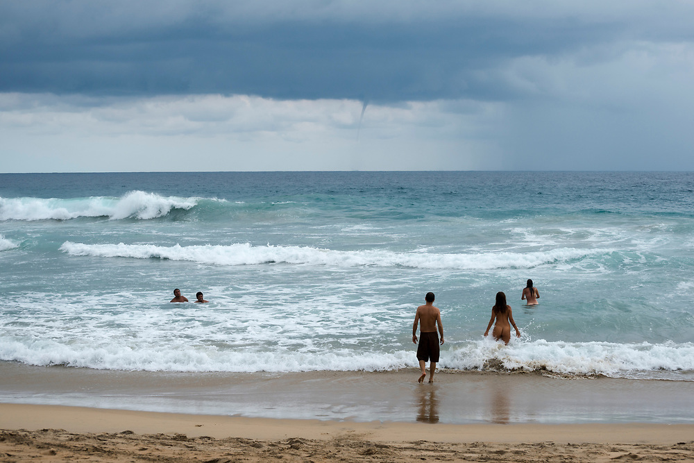 A water spout forms offshore near a clothing-optional beach in Zipolite, Oaxaca state, Mexico. <br /> <br /> (November 2014)