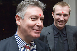 """KATHMANDU, NEPAL - NOV-04-2006 - Karel De Gucht , Belgian Minister of Foreign Affairs and his press secretary Vincent Stuer , share a laugh after receiving a """" Tika """" (the traditional red dot on the forehead) when they arrived at their hotel in Kathmandu. The Tika is offered as a blessing to protect one from evil spirits. (REPORTERS © JOCK FISTICK)"""