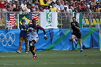 August 11, 2016; Rio de Janeiro, Brazil; USA Men's Eagles Sevens Carlin Isles breaks away from the Spanish defense during the Men's Rugby Sevens 9th Place Final match on Day 4 of the Rio 2016 Olympic Games at Deodoro Stadium. Photo credit: Abel Barrientes - KLC fotos