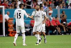 July 31, 2018 - Miami Gardens, FL, U.S. - MIAMI GARDENS, FL - JULY 31: Real Madrid forward Karim Benzema (9)  celebrates with Real Madrid defender Theo Hern‡ndez (15) after scoring a goal against Manchester United during the first half of an International Champions Cup match at Hard Rock Stadium in Miami Gardens, Florida. Manchester United defeated Real Madrid 2-1. (Photo by Douglas Jones/Icon Sportswire) (Credit Image: © Douglas Jones/Icon SMI via ZUMA Press)